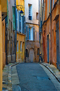 One of the best photos I took in Aix.  I knew the colors were there but did not know how they would look in the photo.  The bicycle was just parked there at the doorway.  Most of the streets in Aix in the old town are one lane, one way and some only wide enough for pedestrians.