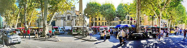 "My first sight of the Aix market on Saturday.  I quietly said, ""Oh boy!  This is gonna be great.""  I took time to take this 6 shot pano of the square.  As I was photographing the panorama I heard an  accordion across the street, my next stop.  This market is made up of hundreds of merchants selling fruits, vegetables, nuts, honey, cured meat, fish, flowers, clothes, hats, ceramics, and some things I can't remember.  Needless to say, everything from a to z was at the market.  I even found some old door knockers."