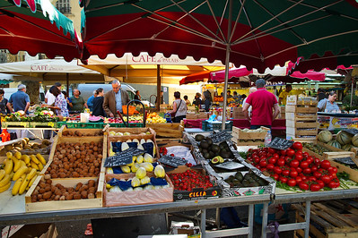 Looking through the market under the canopies you can get some idea of the depth of the the market.  The tomatoes you see are all grown locally.  Provence tomatoes are full of flavor and make a great meal all by themselves.