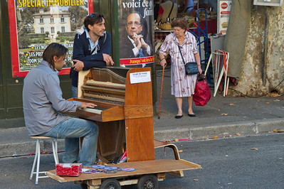 Here is another street musician, a piano player.  He was playing French folk songs and inviting people to sing along with his side kick.
