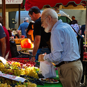 This was one of the better photos I took at the market.  It's of a gentleman buying grapes.  He took the task seriously.