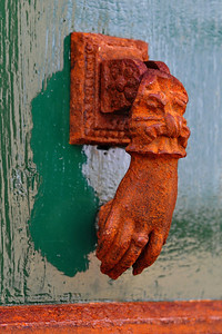 Antibes:  Hand of Fatima door knocker   Antibes is on the Med.  The salt air has hastened the rust condition to the hand door knocker.