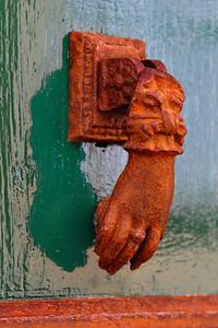 Antibes:  Hand of Fatima door knocker   Antibes is on the Med.  The salt air has hastened the rust condition to the hand door knocker.
