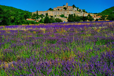St Saturnin les Apt  Driving through this part of Provence and the Vaucluse, I kept seeing field after field of harvested lavender.  I thought that we may be too late in the season to photograph any lavender fields other than the one in front of the abbey.   Leaving the Senanque Abbey we drove east to Roussillon, a village noted for its red colored buildings.  I seemed that hundreds of other tourists had the same thought and they beat us to any available parking.    We didn't stop at Roussillon and continued east to the small village of St Saturnin les Apt.