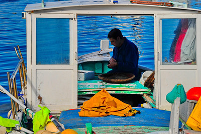 Marseille, France Fish Market and Fisherman repairing his net