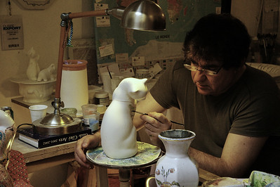 Moustiers St. Marie, Artist Louis Bruno painting a vase