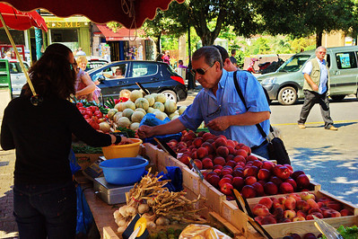 Buying fruit in the town square of Forcalquier