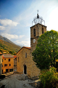 The village church in Greolieres, the clock is right on time.