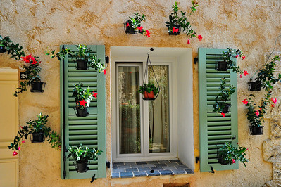 A brightly decorated window in Greolieres