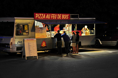 This mobile pizza kitchen was busy after dark.