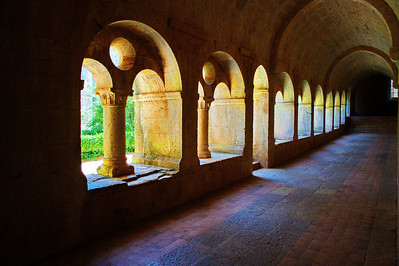 "Cloister at Thoronet: A cloister (from Latin claustrum, ""enclosure"") is a rectangular open space surrounded by covered walks or open galleries, with open arcades on the inner side, running along the walls of buildings and forming a quadrangle or garth. The attachment of a cloister to a cathedral or church, commonly against a warm southern flank, usually indicates that it is (or once was) part of a monastic foundation, ""forming a continuous and solid architectural barrier... that effectively separates the world of the monks from that of the serfs and workmen, whose lives and works went on outside and around the cloister."