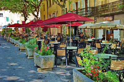 Outdoor cafes line both sides of central Tourtour