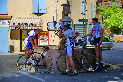 Bicyclists refill their water bottles at Tourtour's fountain