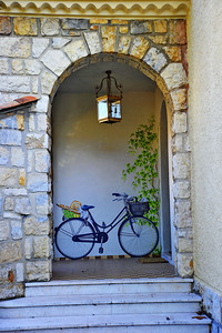 Painted bicycle in the doorway