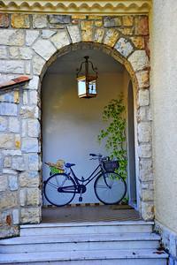 Painted bicycle in the doorway