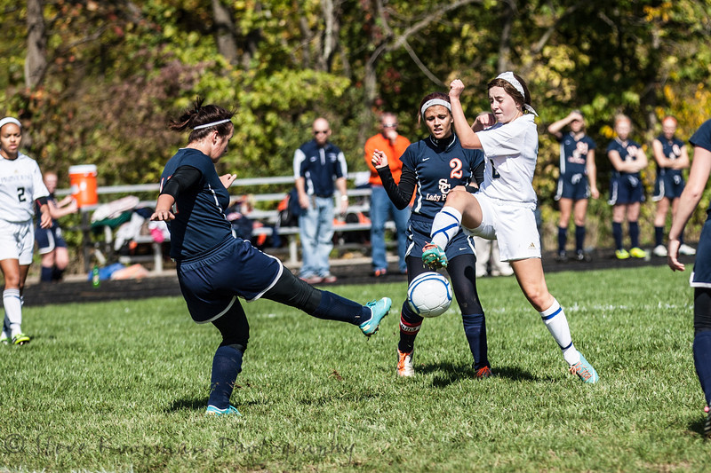 Providence #6 Sarah Posante working to gain possesion of the ball.