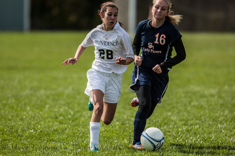 Providence #28 Emma Roesner Taking the ball down the field against defender #16 Bre Braun of Switzerland County