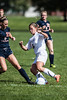 Providence #8 Katie Barron working hard past the defender #21 Paige Sawyer.