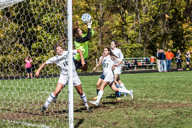 Providence #11 Kasey Wallace going for the ball against Switzerland County #19 Goal Keeper Eve Gallbreath.