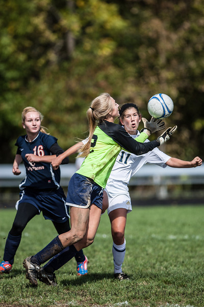 Providence #11 going for the ball against goal keeper #19 Eve Galbreath