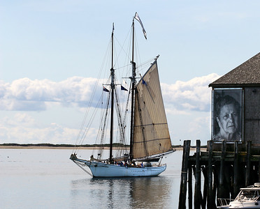 "The Spirit of Massachusetts coming into port past the exhibit ""They Also Faced The Sea"" on Fishermans Pier in Provincetown, MA.  This exhibit of powerful and insightful photos by Norma Holt welcomes everyone coming into or leaving Provincetown Harbor.  This photograph can be seen as  a two page feature in the 2008 Provincetown Pocketbook 15th Anniversary Magazine.  Our close friend Norma passed away in July 2013 at 94."
