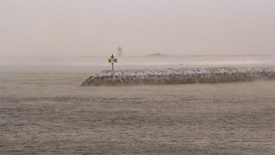 A view of the long point lighthouse looking past the breakwater on a January morning when the temperature was -5 degrees farenheight.