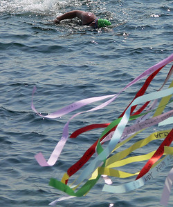 Paul Mast from NJ nearing the prayer ribbons at the finish line of the annual Swim For Life.  This shot can be found in the 15th Anniversary Issue of the Provincetown Pocketbook Magazine published in 2008.