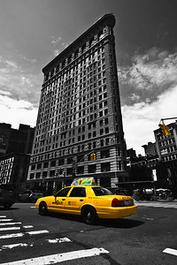 Yellow cab in front of Flat Iron Building