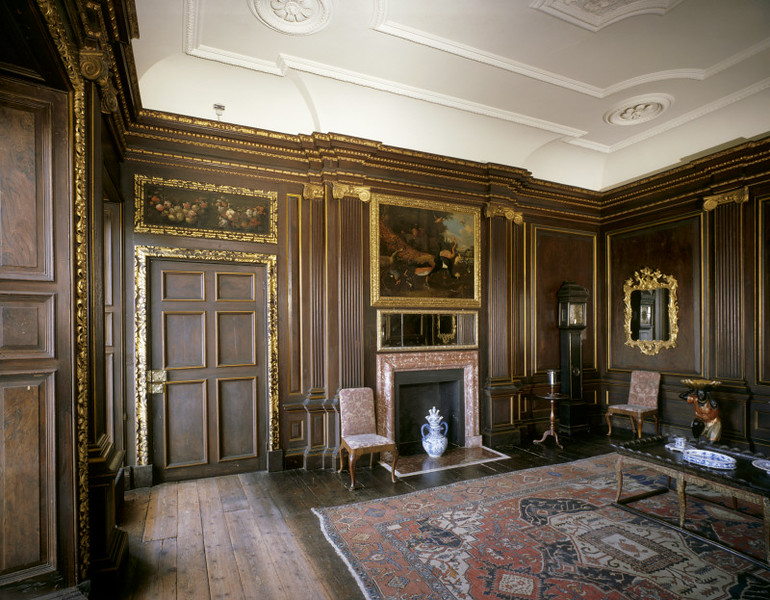 Room view of the Balcony Room at Dyrham Park showing the early 18th century wood grain panelling.