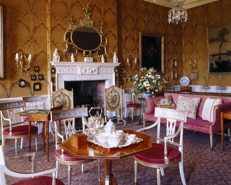 The opulent interior of the Drawing Room, with its 18th Century Italian styled wallpaper and numerous furnishings.