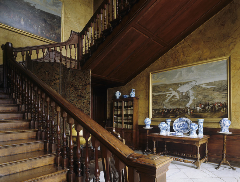 The Cedar Staircase at Dyrham Park. The stairs lead the full height of the building. The treads are of Virginian walnut, the risers and balusters are of cedar from America.