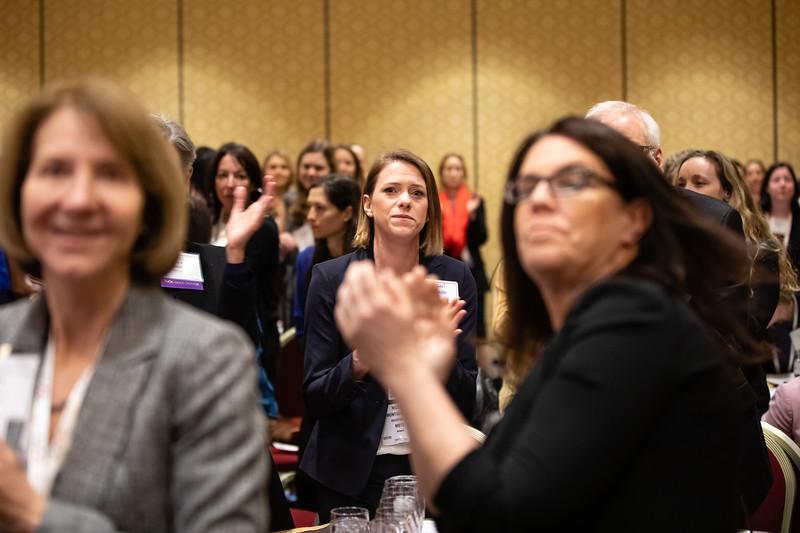 Attendees applaud as Kristy L. Weber, MD, speaks during RJOS Annual Meeting
