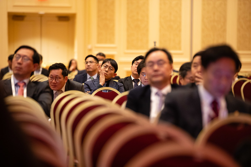 Speakers and attendees during Guest Nation Symposium: