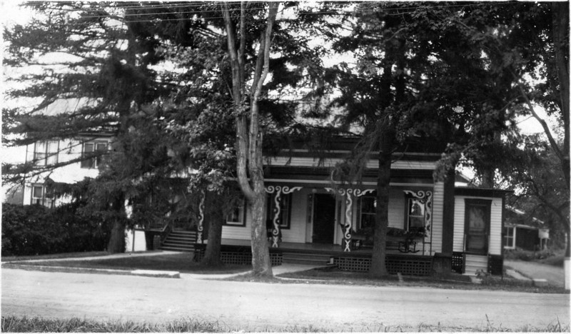 Dr. Skinner's residence with an ornate porch. Genoa, NY. Hospital in background on the left. (Photo ID: 27939)