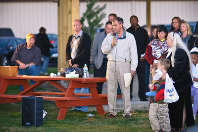 Randy Settle speaks at a candlelight vigil in honor of 4-year old Jeremiah L. Bradford
