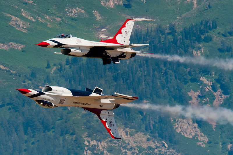 Two Thunder Bird Plans do a mirroring maneuver during the Air Show. In Layton On June 29, 2014.  (BRIAN WOLFER/Standard-Examiner)