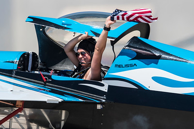 Mellissa Pemberton  waves a American flag after her performance at the Warriors Over the Wasatch air show on Hill Air Force Base in Layton on June 26, 2016.
