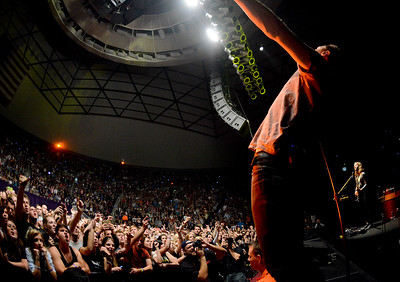 Lead vocalist Dan Reynolds gets the crowd into the music by dancing around the stage at the Imagine Dragons concert. In Ogden, on October 23 2013. (Brian Wolfer Special to the Standard-Examiner)