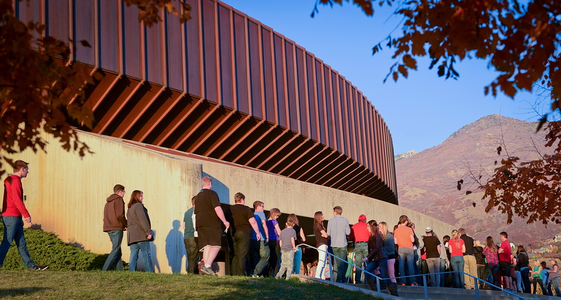People wrap around the side of the Dee Events Center to watch and enjoy Imagine Dragons. On October 23 2013. (Brian Wolfer Special to the Standard-Examiner)