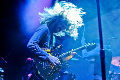 Wayne Sermon from Imagine Dragons dances around the stage as he performs. At the Dee Events Center in Ogden On October 23 2013. (Brian Wolfer Special to the Standard-Examiner)