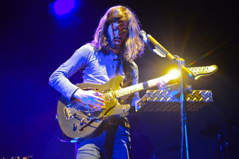 Imagine Dragons guitarist Wayne Sermon performs to a sold out crowd. at the Dee Events Center in Ogden On October 23 2013. (Brian Wolfer Special to the Standard-Examiner)