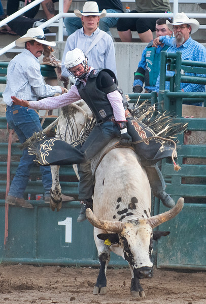 Kyler Oliver participates in the Bull Riding competition, during the Weber County Unfair Rodeo, At the Golden Spike Arena in Ogden, on Augest 5, 2020.
