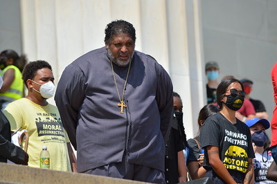 """Rev. William Barber of the """"Poor People's Campaign"""", about to speak from the steps of the Lincoln Memorial at the """"Make Good Trouble"""" rally for voting rights in Washington, DC on August 28th, 2021."""