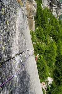 "Matej Stular on the first belay in ""Canabis"" 7b+, Sergent, Valle dell'Orco, Italy."