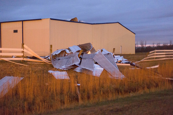 Large sheets of metal were torn from the building and piled on the ground. This photo was taken at night.