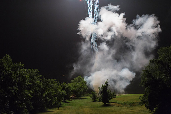 I've always found the smoke to be facinating. There's something spooky about it, yet pretty when it's lit by the colors. This smoke was bright from the sudden flash of a firework.