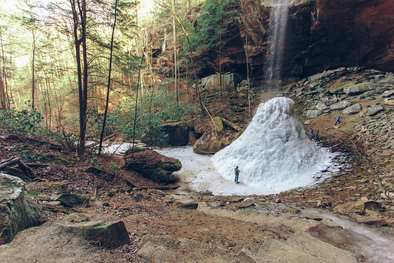 My husband looks very small compared to this frozen waterfall.