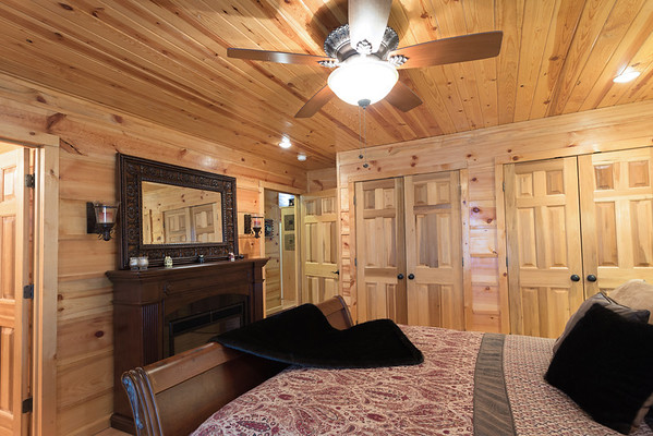 The master bedroom had a double closet and a cozy fireplace.