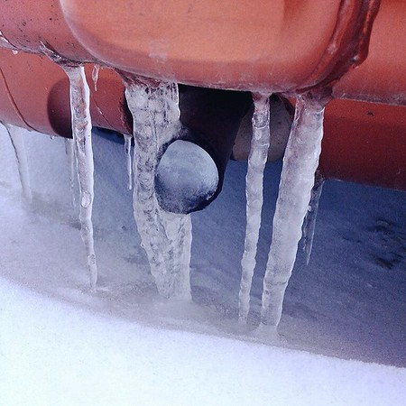 Good thing I don't have travel plans. It would take quite an amount of hot water to thaw the solid ice. The temperature is currently in the teens falling to double digit below zero! Safety Reminder: before starting your vehicle, check exhaust pipe for snow/ice.