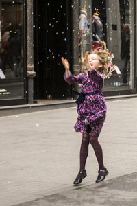 Girl catching bubbles on Istiklal street in Istanbul
